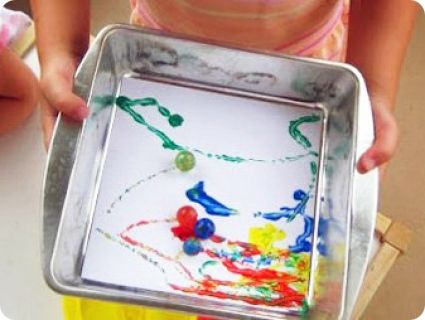 DIY: Roll Around Some Colorful Fun with Marble Painting!