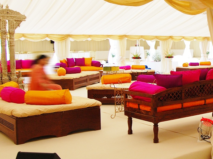 Indian Style Dark Wood Sofas With Color Coordinated Pillows For