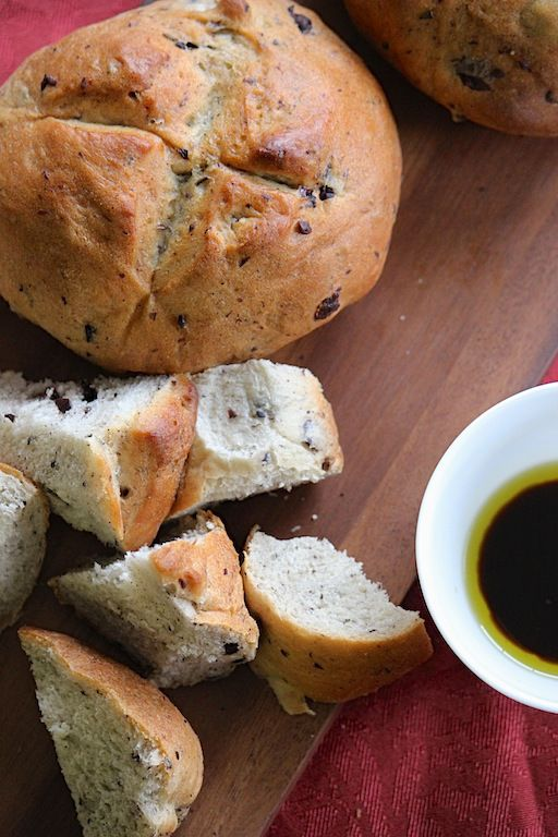Rosemary and Kalamata Olive Artesian Bread served with olive oil and ...