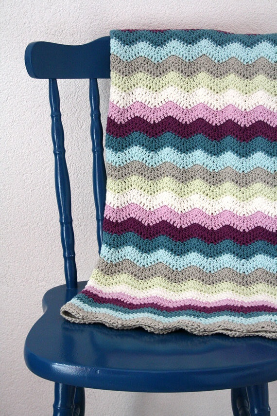 Crochet ripple baby blanket in blue, purple, cream