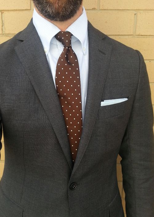 Dark grey suit, white shirt with light blue dress stripes, brown tie
