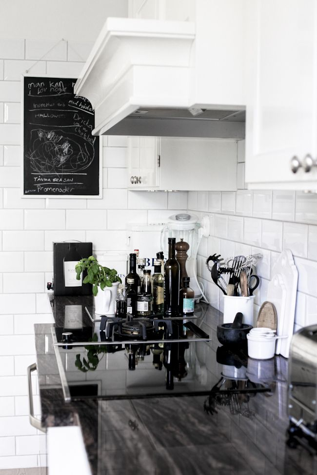 Classic kitchen. White subway tile. Black bench.