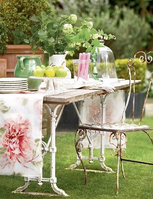 Garden party with rusted ironwork furniture.