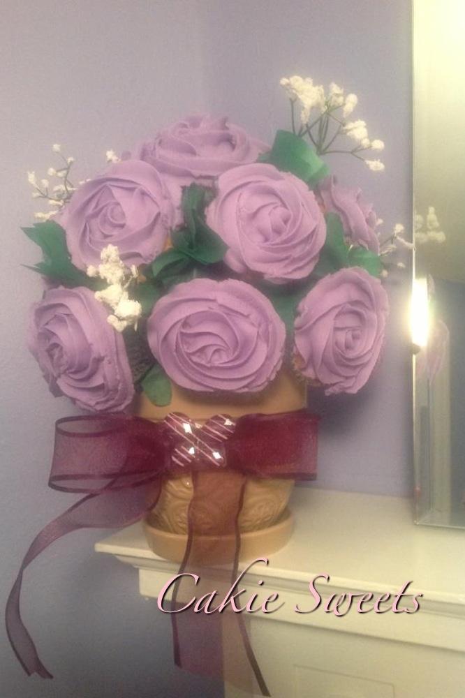 Genieva CakieSweets Lavender colored rose cupcake bouquet.