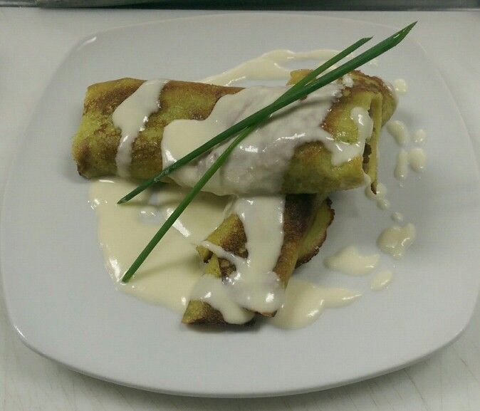 Wild mushroom stuffed herb crepes with monterrey cheese sauce