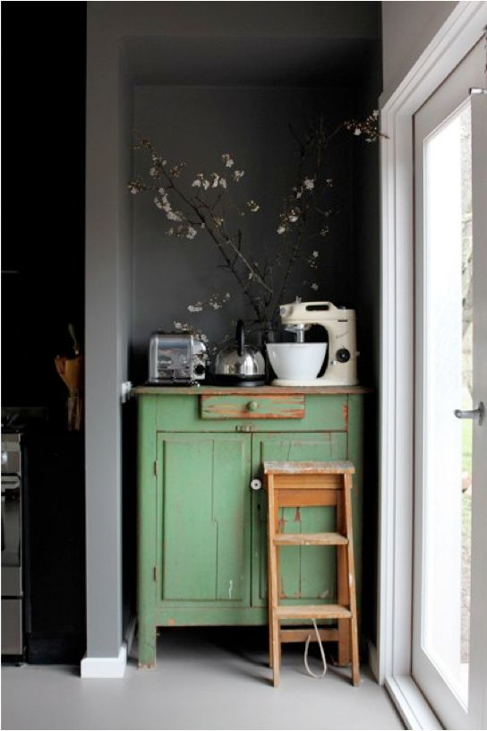 Mmm Green chippy paint on a cute cabinet is a perfectly tucked away