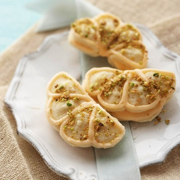 Elegantly beautiful, pistachio topped Orange-Ginger Shell Cookies.