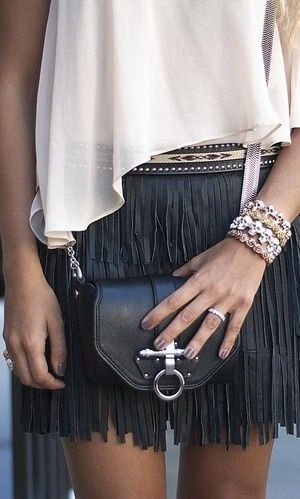 Black Fringe Mini Skirt + Sheer white top. Love the small cross body purse and stacked bracelets.