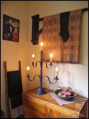 "Primitives. Love the quilt hanger - it's called a ""Blanket Crane."""