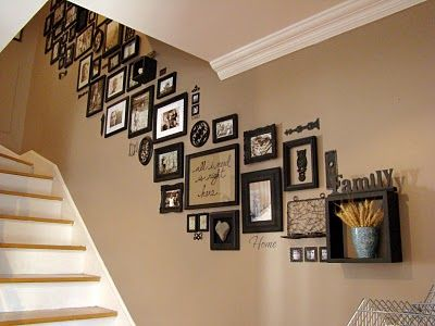 Picture frames on staircase wall: I love this look; unified though with a lot of variation in frame types, some of the items on the wall aren't even pictures.