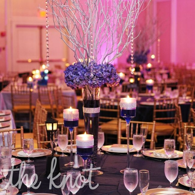 Purple and silver tall centerpiece wedding ideas