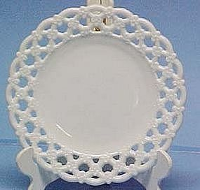 antique milk glass, Westmoreland Forget Me Not.  There are small flowers at the nexus of the lace.