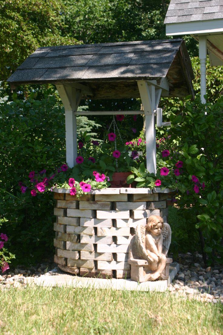 Wishing well gardening pinterest for Garden well designs