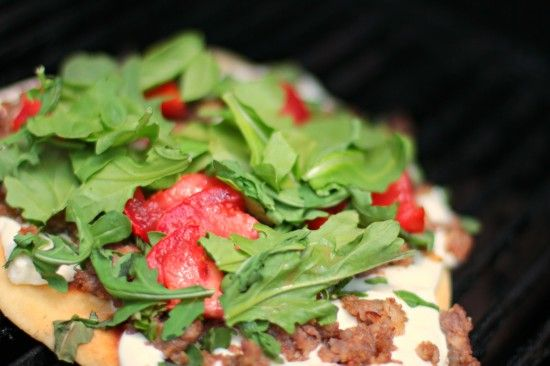 Grilled naan pizza with arugula, basil, Italian sausage and fresh ...