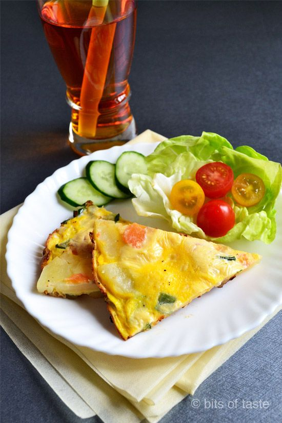 Spanish Omelette - with cooked potato slices, zucchini and fresh ...