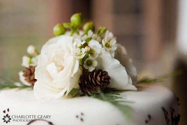 Wedding cake topper with pine cones - thought I would hate the pine ...