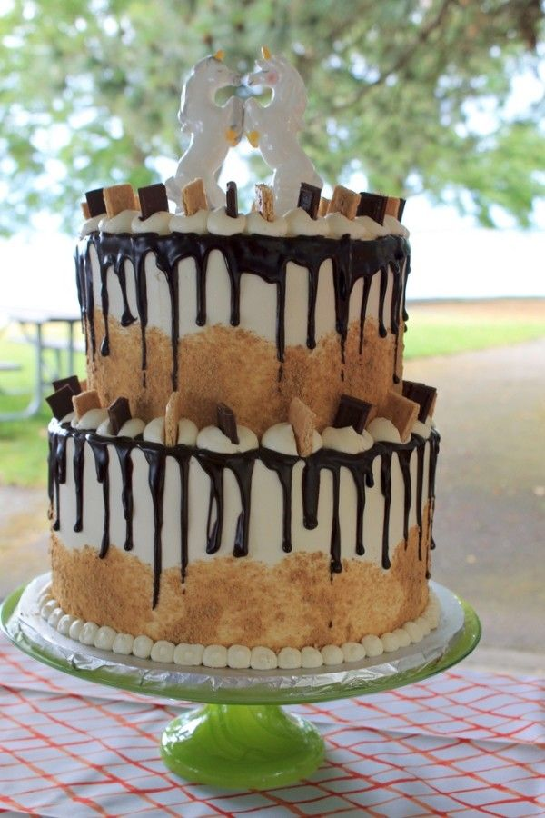 Glorious s'mores wedding cake by Wanna Cupcake. (Mega extra credit for the unicorn cake topper!!)