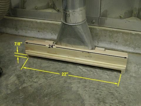 Make one for behind mitre saw and hook up to shop vac underneath bench