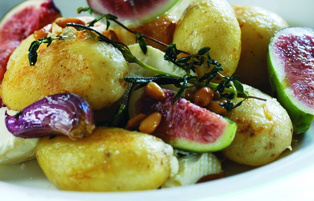 Warm salad of Jersey Royals with goat's cheese, pine nuts and fresh f ...