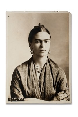 "Frida, 1932, by Guillermo Kahlo, framed in the show as an image in ""Frida at four stages of her life."" This photo was taken seven years after a devastating crash that would partly define her life. The bus in which she was riding collided with a trolley car, breaking her spinal column, collarbone, ribs and pelvis, putting her in a full body cast for three months. She began to paint shortly after the 1925 accident to fill her time."
