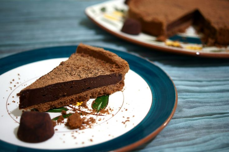 Chocolate Truffle Tart Dusted with Cocoa Powder | Flavorful Journeys