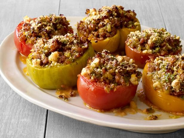 Recipe of the Day: Sausage-Stuffed Tomatoes from #FNMag         Fill up seasonal tomatoes with a flavor-packed mixture of sausage, peppers and bread, then bake and serve with a spiced tomato sauce.          #RecipeOfTheDay
