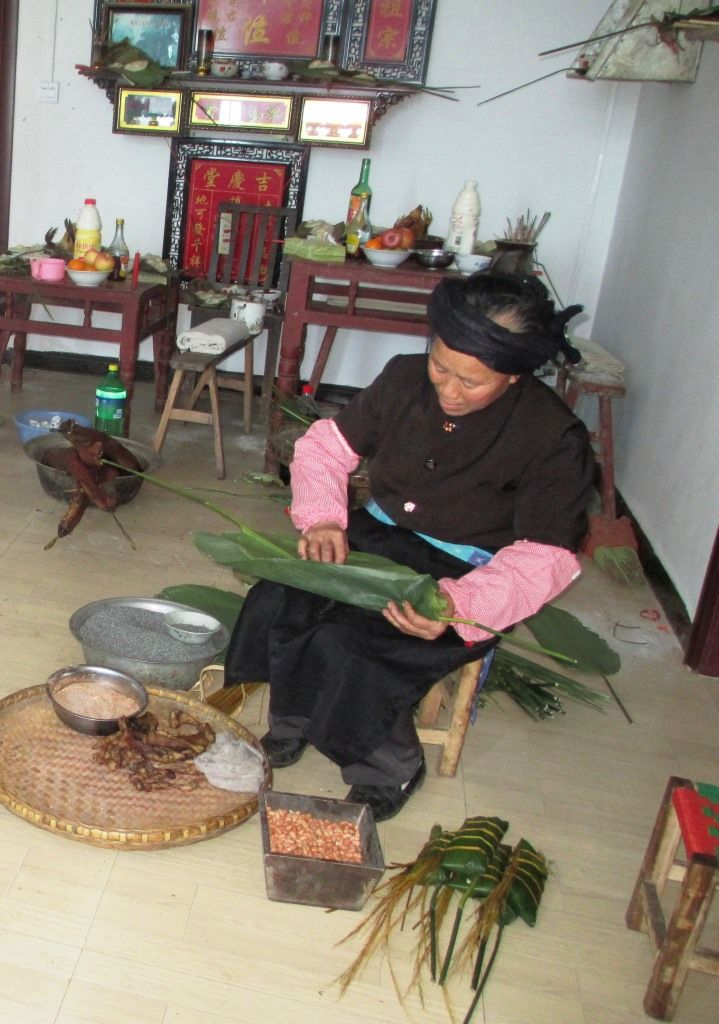 Yaya's Mother made sticky rice packages of bacon, nuts,  leaves and charcoal rice.