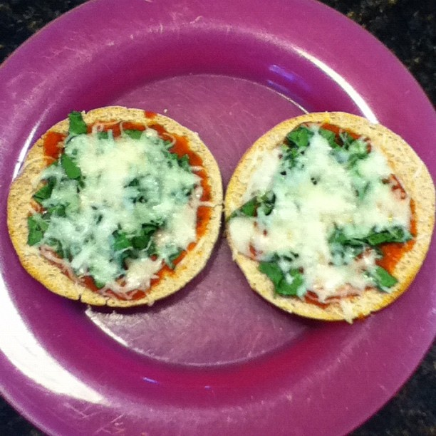 Mini spinach pizzas: 1. toast 100 calorie roll 2. put tomato/pizza ...