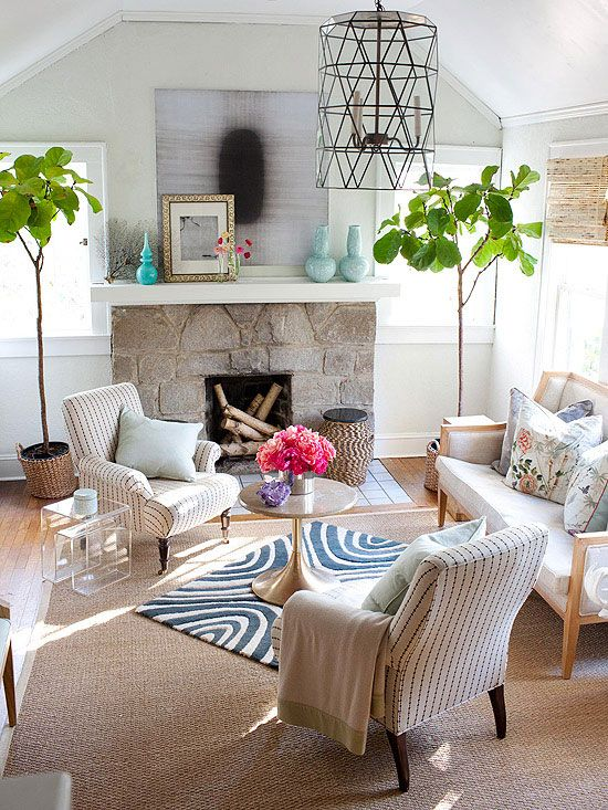 Layer Rugs for Richness. A neutral rug on the bottom with a smaller, colorful accent rug on top.