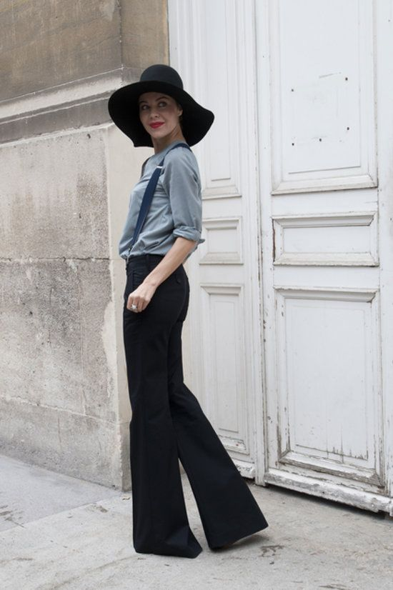 Ulyana Sergeenko added interest with a floppy hat — and mastered the street style pose. #pfw #ss14 #streetstyle