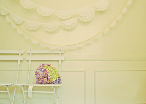 diy: the paper lace garland with triangle burlap bunting behind dessert and gift table.