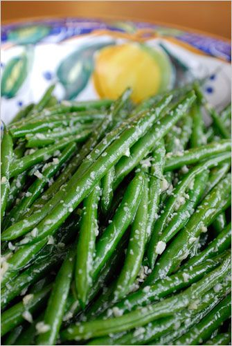 tosses string beans, a clove or two of minced garlic and lemon zest ...