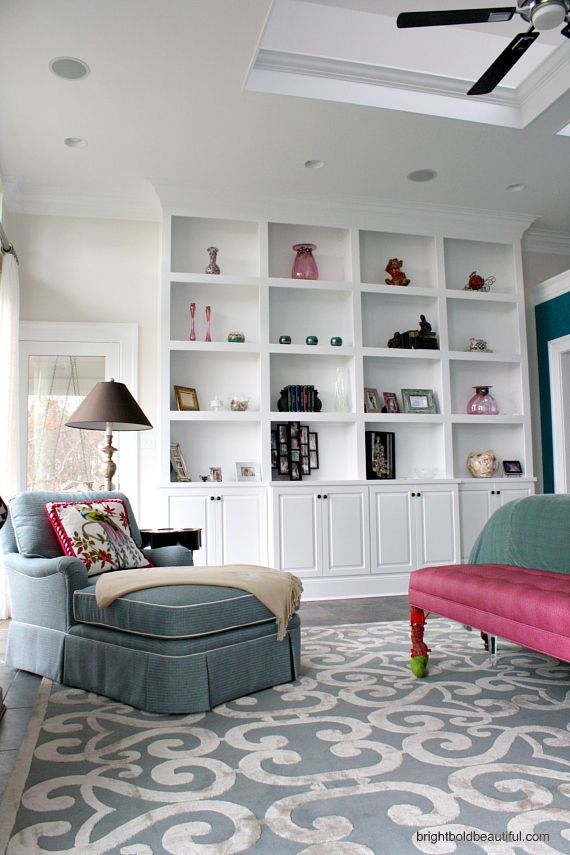 Holiday Home Tour - Paula Holm - Bright Bold and Beautiful Blog.  This really irks me.  Why do you have built ins and you don't need them?  You have no stuff...