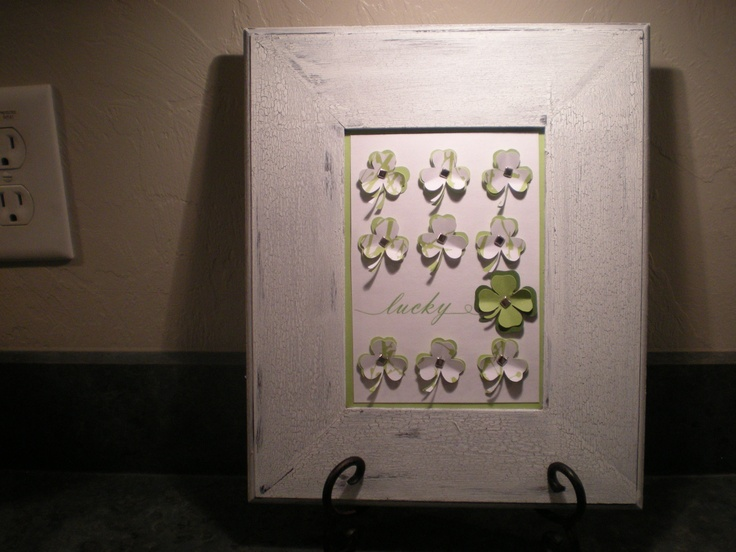 """I made this to put on my mantel. Bought the wood frame & painted it. Cut the 3 & 4 leaf clovers out with my Silhouette & printed the """"Lucky"""" on with my printer.  The whole thing cost about $5 to make, if that. Happy St. Patrick's Day!"""