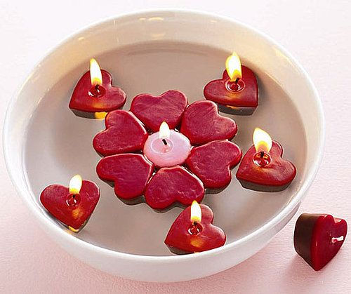 Shaped floating candles clustered in a bowl make a lovely centerpiece