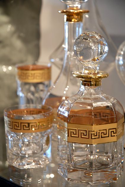 gold and glass decanters w/ Greek key design