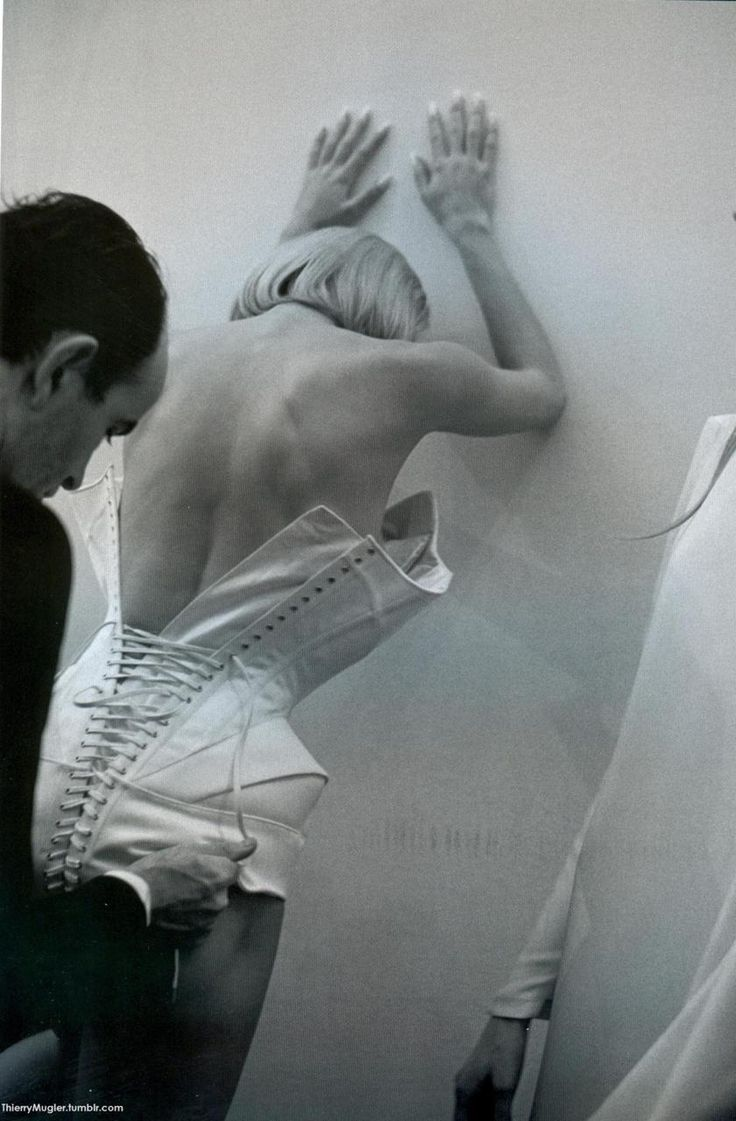 Mr. Pearl laces up a corset swimsuit with white satin panels worn by Inna Zobova.  Thierry Mugler Haute Couture Collection SS 1998