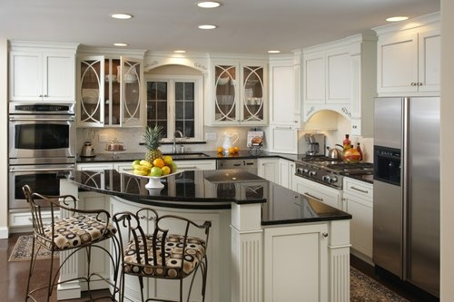 Cream kitchen cabinets to go with our black granite countertops looks