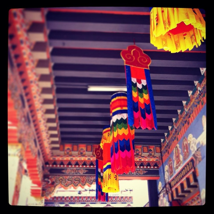 Flags with colors representing the five elements hang from the central monastery at the Thimphu Dzong. (Bhutan)