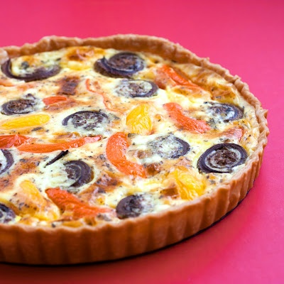 sweet pepper, fiddlehead and goat cheese tart