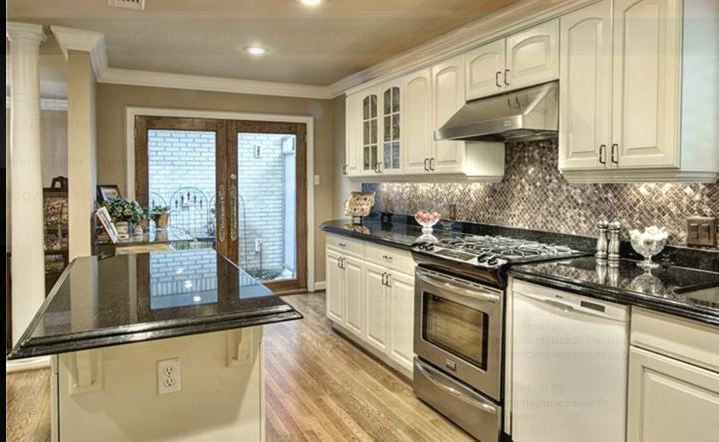 White kitchen with black galaxy granite for White kitchen cabinets with black galaxy granite