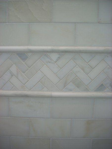 White subway tile with mosaic border