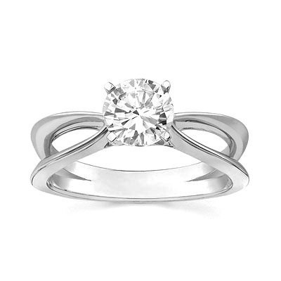 Simple and sophisticated round cut diamond engagement ring
