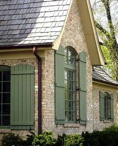 Board-and-batten shutters (these are from Designer Doors www.designerdoors.com) give a house a picturesque look.