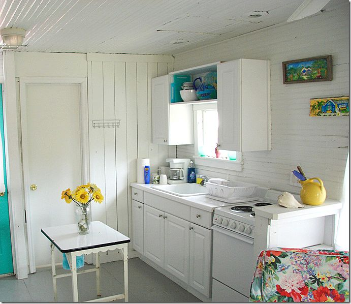 Sweet little beach cottage kitchen for my new kitchen for Beach cottage kitchen cabinets