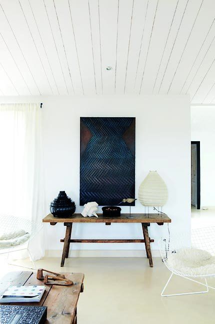 Beautiful, simple interior. I love the mixture of styles and eras... held together by the white, blue and brown palette.