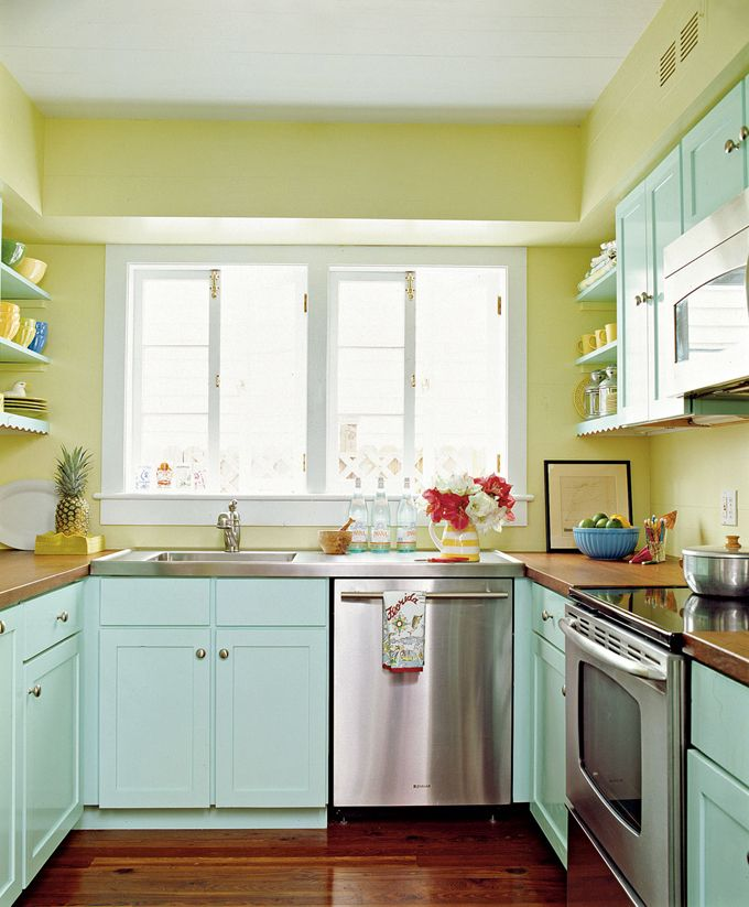I am crazy about the yellow - teal combo in here. Plus, this is about the same size as my kitchen...