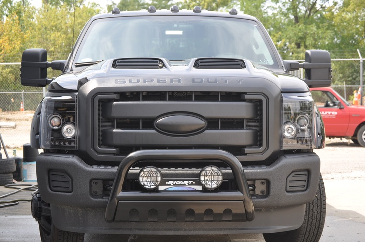 "T-Rex F-350 with painted Ram air hood - painted Ford emblem - black bullbar with lights - ""line-x"" wrapped front bumper; smoke cablights and side mirror signal lights."