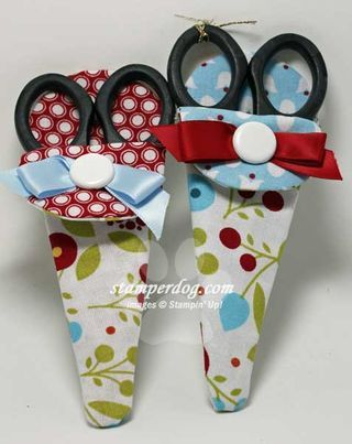 Cute scissor holders made with some Stampin' Up! Summer Smooch fabric. The fabric was cut using a dresden plate die and made by Ann Clemmer.