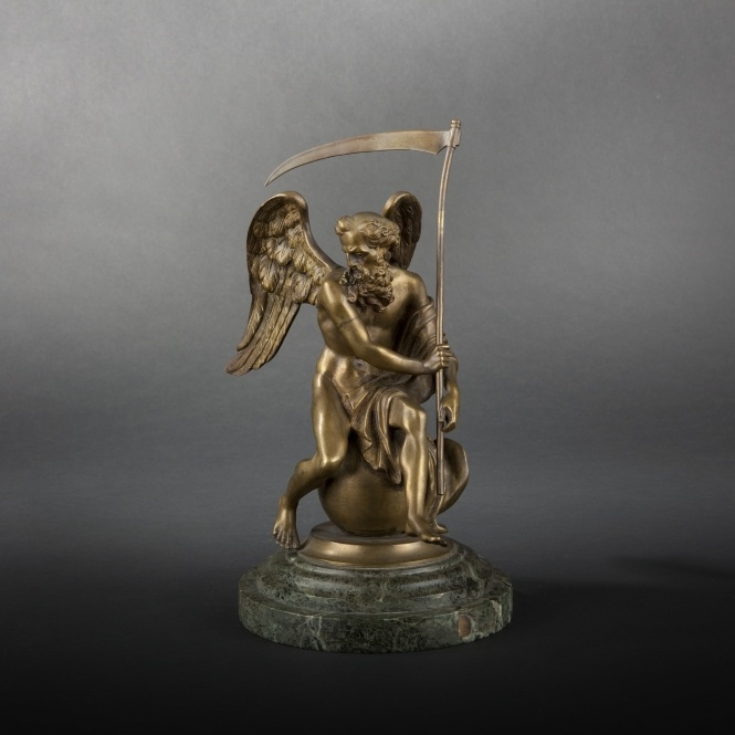 """""""Chronos dominant le monde"""" (Chronos Dominating the World).    Gilt and chiseled bronze sculpture, atop circular green marble base.    Height: 30 cm (11-3/4 in.) (including marble plinth)."""